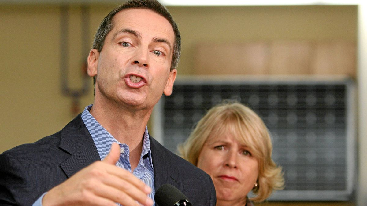 Ontario Premier Dalton McGuinty speaks to the media in front of Health Minister Deb Matthews at the University of Western Ontario in London, Ontario, Thursday, Sept. 8, 2011.