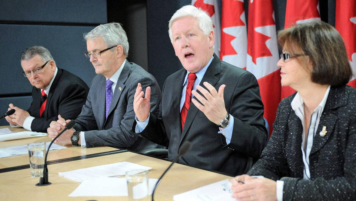 Flanked by MPs Ralph Goodale, Marc Garneau and Judy Foote, Interim Liberal Leader holds a news conference in Ottawa on Dec. 13, 2011, to mark the end of the fall sitting of Parliament.