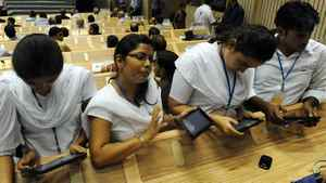 "Indian students use the newly launched ""Akash"" the long-awaited ""computer for the masses"", unveiling a tablet device designed to bring the information technology revolution to tens of millions of students. Datawind, the Canada-based manufacturer, said the government was buying 100,000 of the tablets at $46 each to be given away for free to university and college students."
