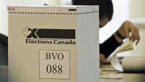 An Elections Canada worker checks a voter list at a Montreal polling station on May 2, 2011.