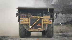 A pickup truck leads a haul vehicle at an oil sands mine near Fort McMurray, Alta., July 9, 2008.Researchers doubt that oilsands-damaged land can be restored to what it was.