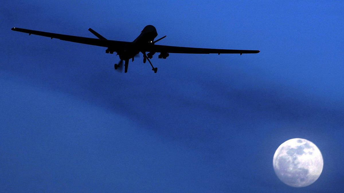 In this Jan. 31, 2010 file photo, an unmanned U.S. Predator drone flies over Kandahar Air Field, southern Afghanistan, on a moon-lit night.