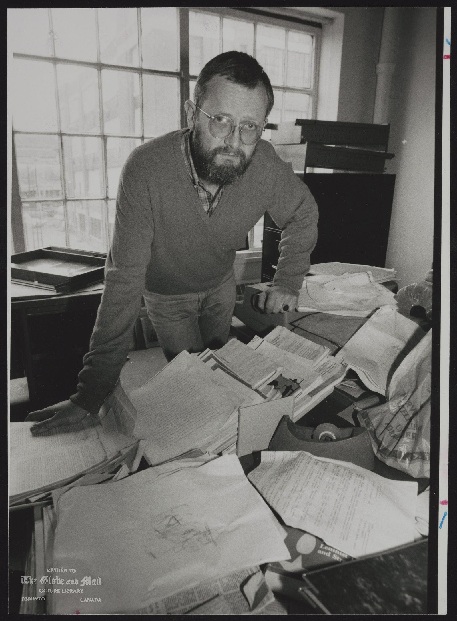 UNIVERSITY OF TORONTO Sociology Dept. Professor Michael Bodemann stands in flooded office.