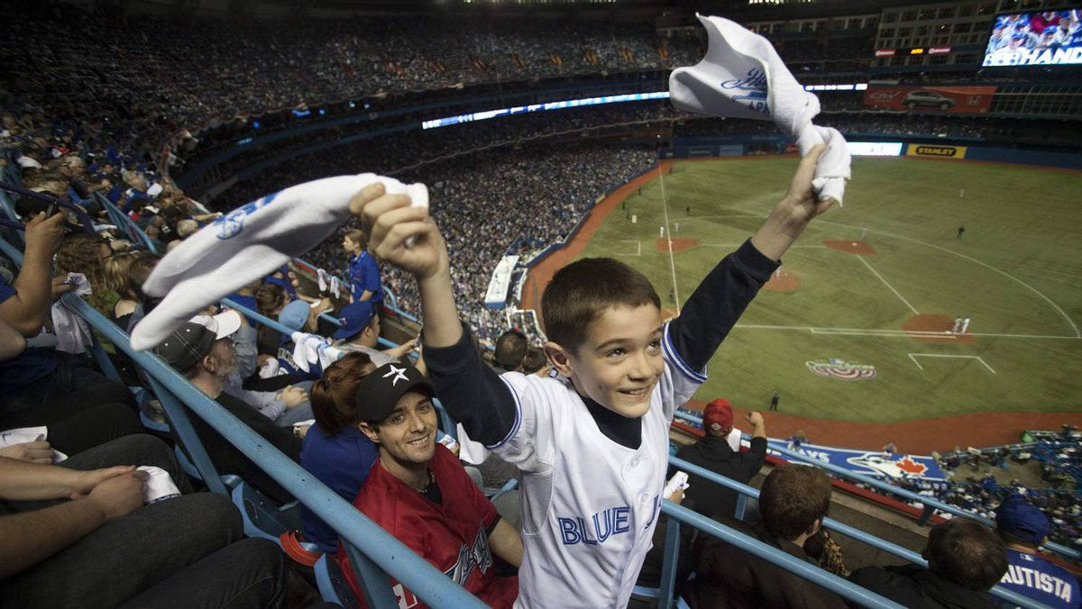 Toronto Blue Jays fans wave rally towels at the team's MLB American League baseball home opener against the Boston Red Sox in Toronto April 9, 2012.