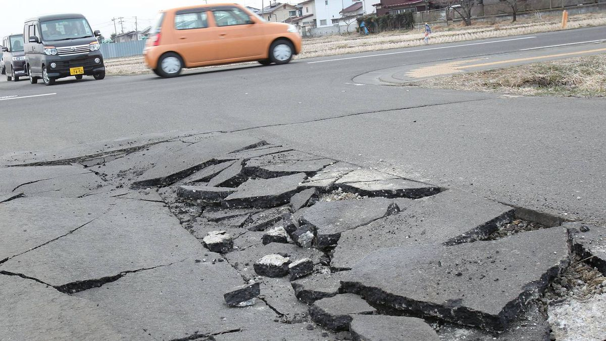 A damaged road is seen after an 8.9 magnitude strong earthquake struck on March 11 off the coast of north-eastern Japan, on March 13, 2011 in Sendai, Japan. The quake struck offshore at 2:46pm local time, triggering a tsunami wave of up to 10 metres which engulfed large parts of north-eastern Japan. The death toll is currently unknown, with fears that the current hundreds dead may well run into thousands.