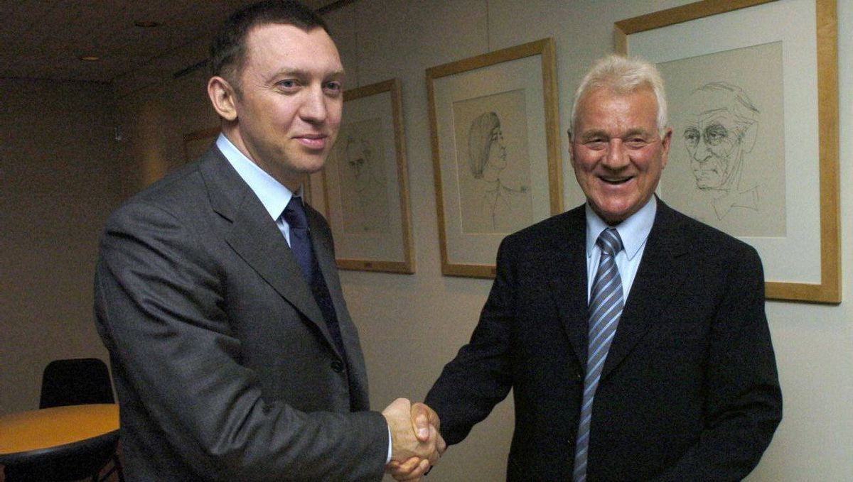 Frank Stronach shakes hands with Russian billionaire and automotive entrepreneur Oleg Deripaska. Deripaska made a $1.54-billion investment in Magna in 2007.