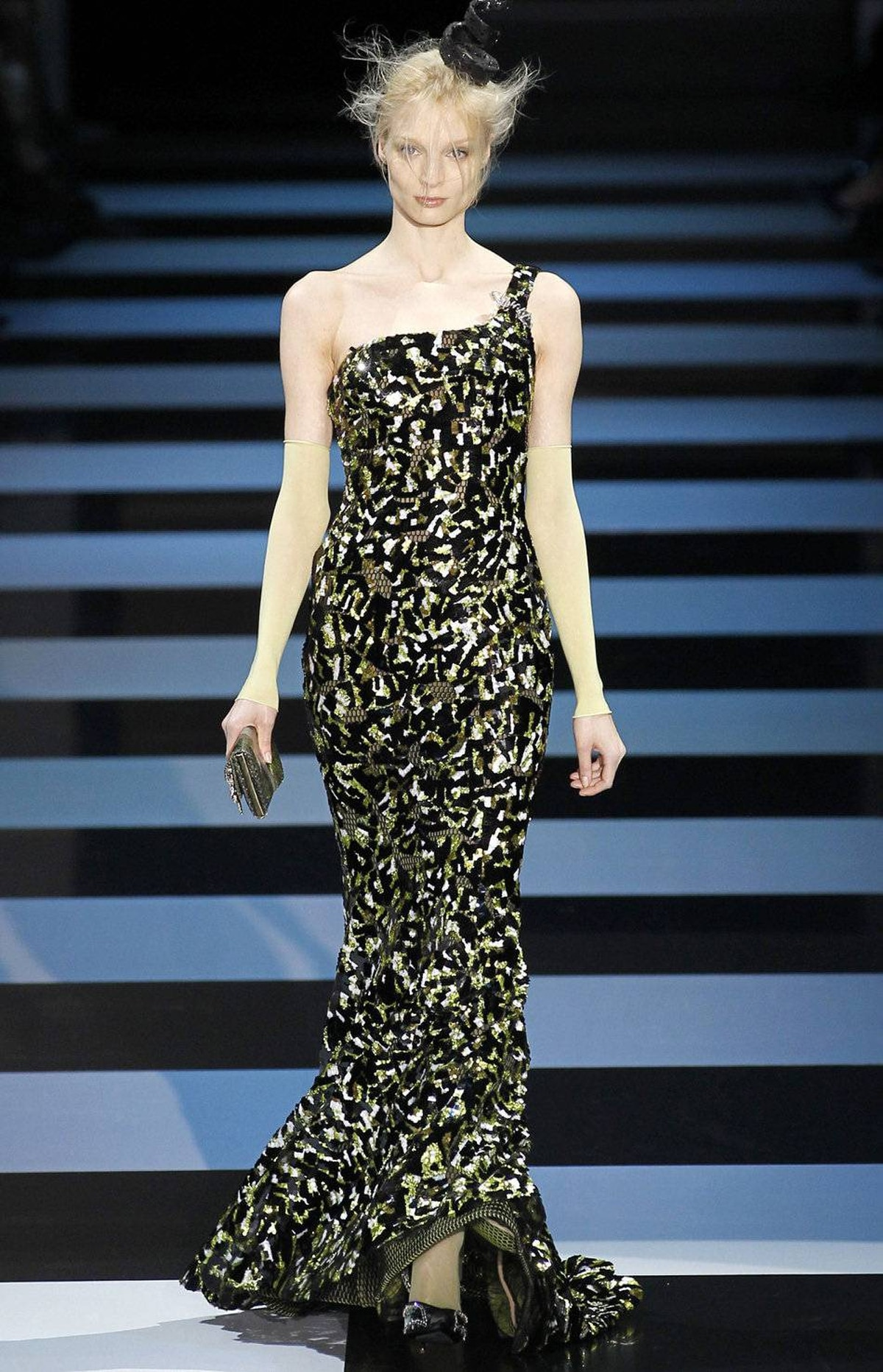 Minutes before the Giorgio Armani Privée show started, applause erupted from the front row. Actress and guest Jessica Chastain had just received news about her Oscar nomination (for The Help). So if it wasn't before, the show became a reconnaissance mission. Could this paillette-covered mermaid dress be the one?