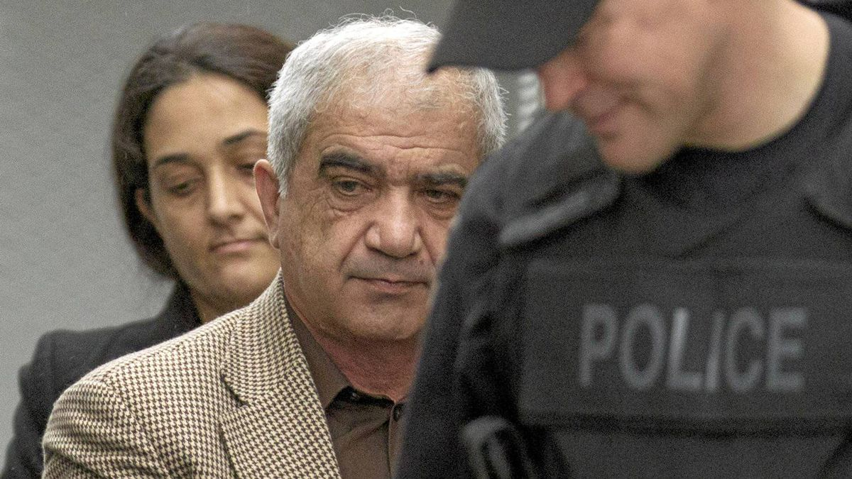 Mohammad Shafia (front) and Tooba Yahya are escorted into the Frontenac County courthouse in Kingston, Ontario on Friday, January 27, 2012.