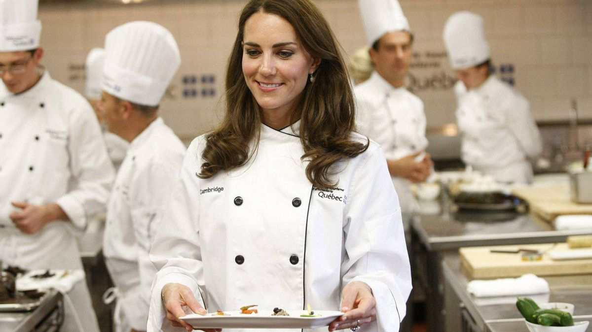 The Duchess of Cambridge carries a tray of hors d'oeuvres during a visit to the Quebec Tourism and Hotel Institute in Montreal on Saturday, July 2, 2011.