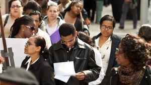 Unemployed workers wait in line to get into a job fair in New York on Oct. 2.