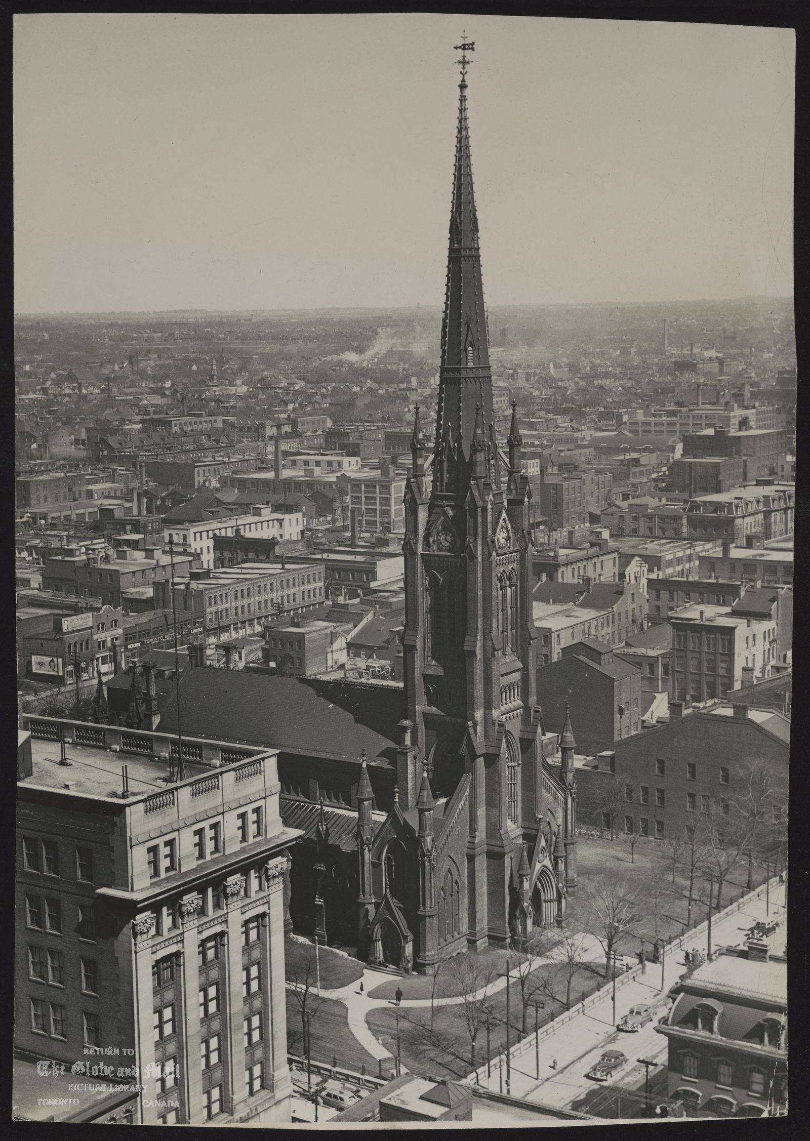 The notes transcribed from the back of this photograph are as follows: ANGLICAN CHURCH OF CANADA Toronto St. James Cathedral King St. 1956 [from King Edward Hotel roof]
