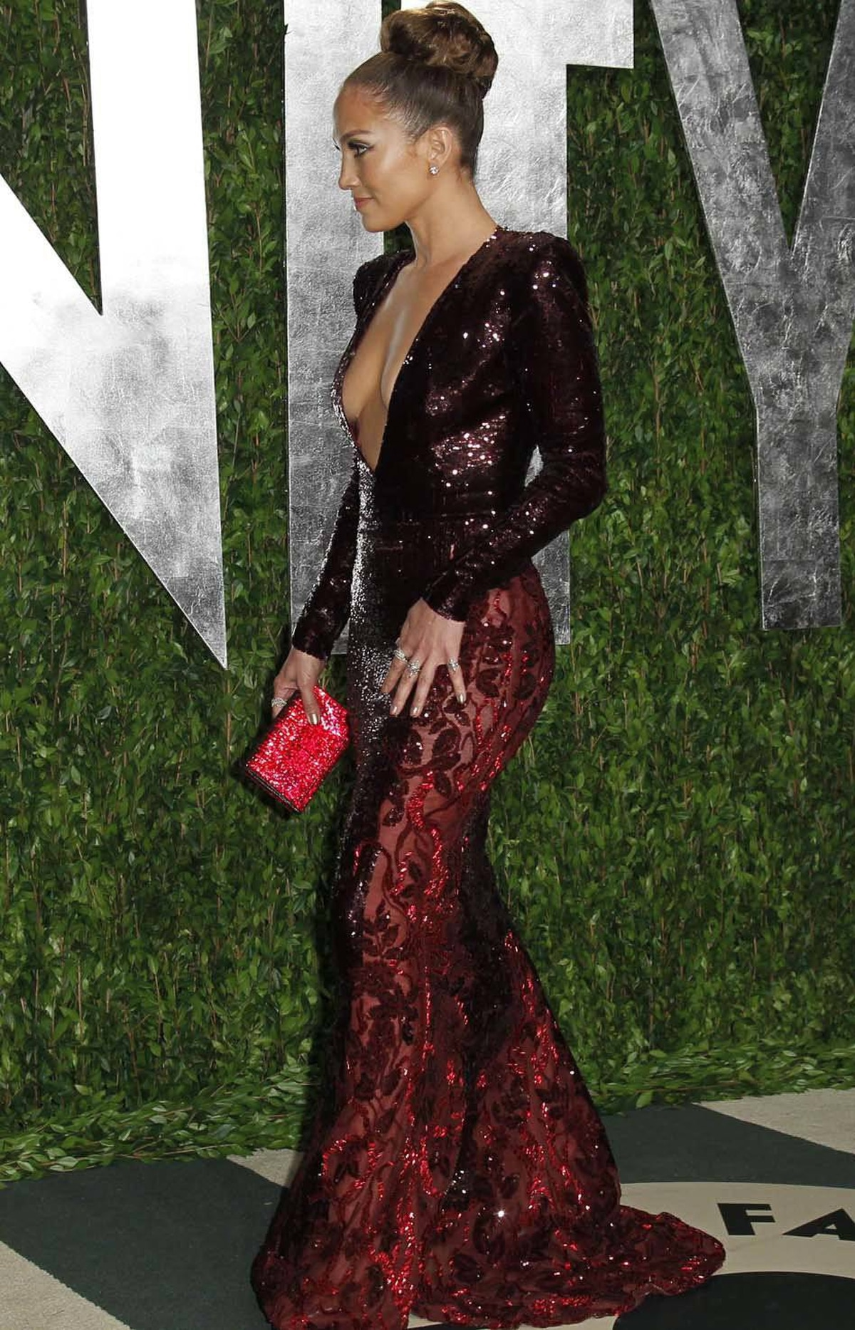 Jennifer Lopez points the way to the door at the Vanity Fair Oscar party in West Hollywood on Sunday.