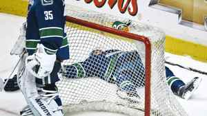 Vancouver Canucks defenceman Dan Hamhuis lies behind the net after he was knocked hard into the boards by Ryan Getzlaf of the Anaheim Ducks during Wednesday's game in Vancouver. Andy Clark/Reuters