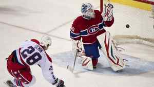 Washington Capitals' Alexander Semin scores on a penalty shot past Montreal Canadiens goalie Peter Budaj third period NHL hockey action Saturday, February 4, 2012 in Montreal.