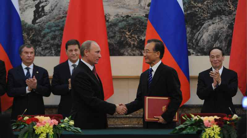 Russian Prime Minister Vladimir Putin meets Chinese Premier Wen Jiabao at the Great Hall of the People in Beijing on Tuesday.