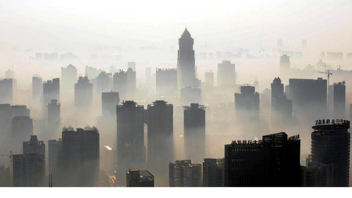 Air pollution shrouds buildings in the Chinese city of Wuhan. China will need to invest up to $30-billion a year to meet its goal of curbing greenhouse gas emissions, the state press said, citing an academic study, as Beijing set its targets before world leaders prepare to gather in Copenhagen for talks on negotiating a new global warming pact to replace the Kyoto Protocol. STR/AFP/Getty Images