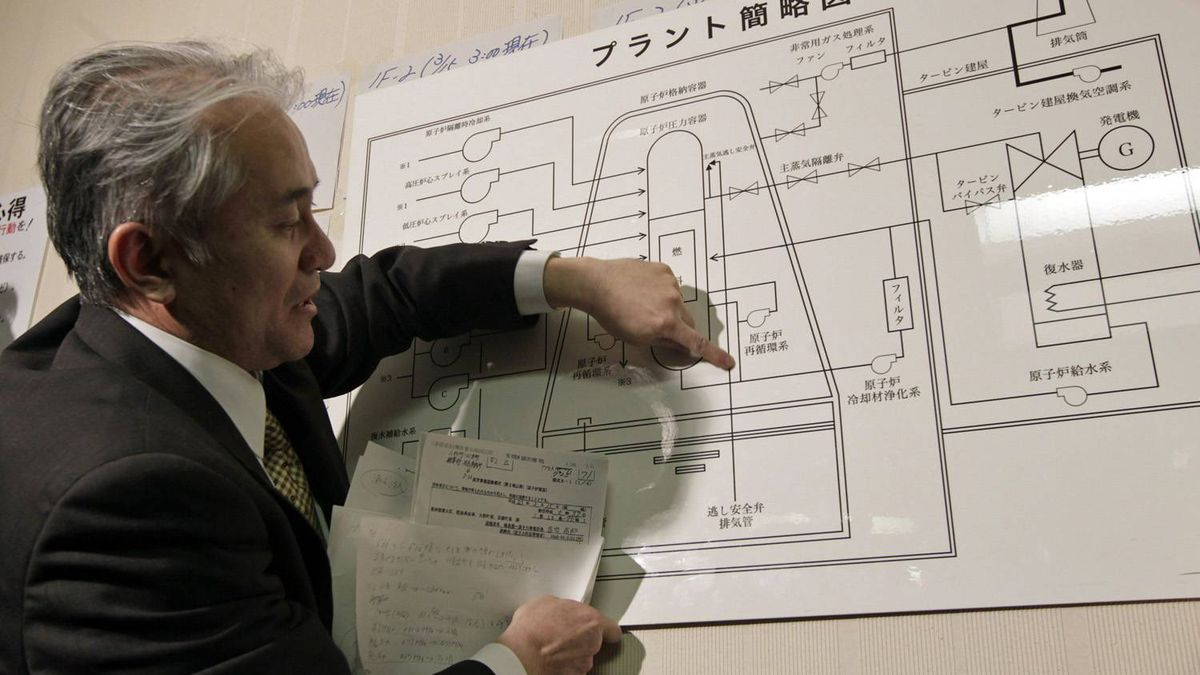 A Tokyo Electric Power official points at an illustration of a nuclear plant as he answers reporters' questions at the disaster centre in Fukushima, northern Japan on March 15, 2011.