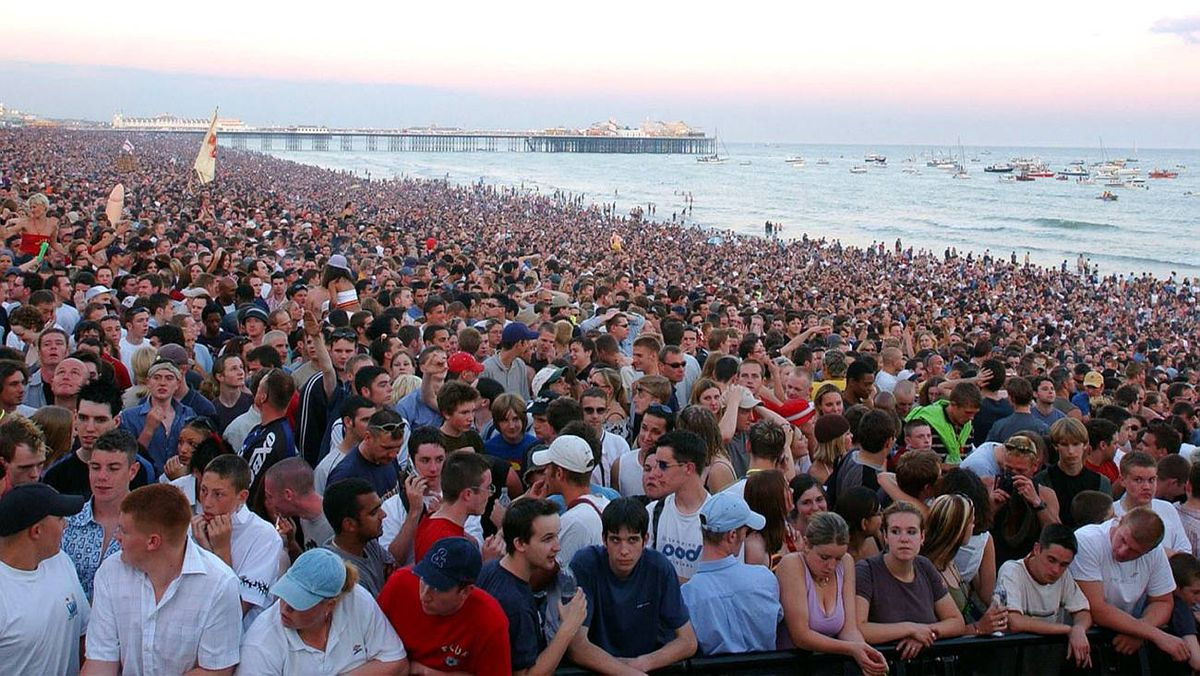 Some of the 200,000 crowd at Brighton beach, southern England in July, 2002, during Europe's biggest free beach party. A dating website says fewer than one in eight British men would be considered beautiful enough for its users.