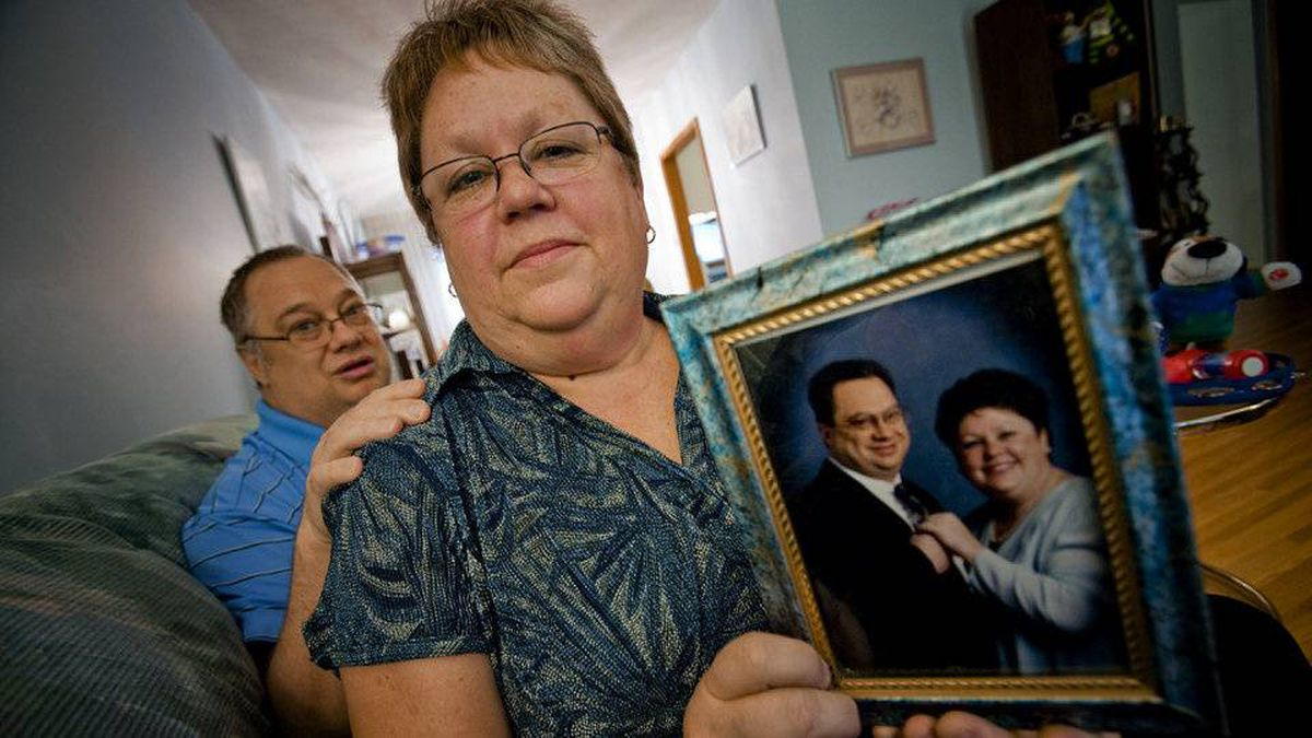 Susan Gustafson and her husband, Dave, at home in Winnipeg. Dave, 57, was diagnosed with dementia in 2008.