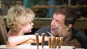"""Riley Thomas Stewart (left) and Mel Gibson in a scene from """"The Beaver."""""""