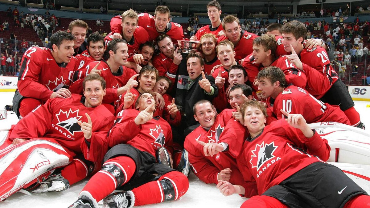 Members of Team Canada gather around the Super Series trophy after Canada defeated Team Russia 6-1 in the eighth game of their Super Series at General Motors Place September 9, 2007 in Vancouver.
