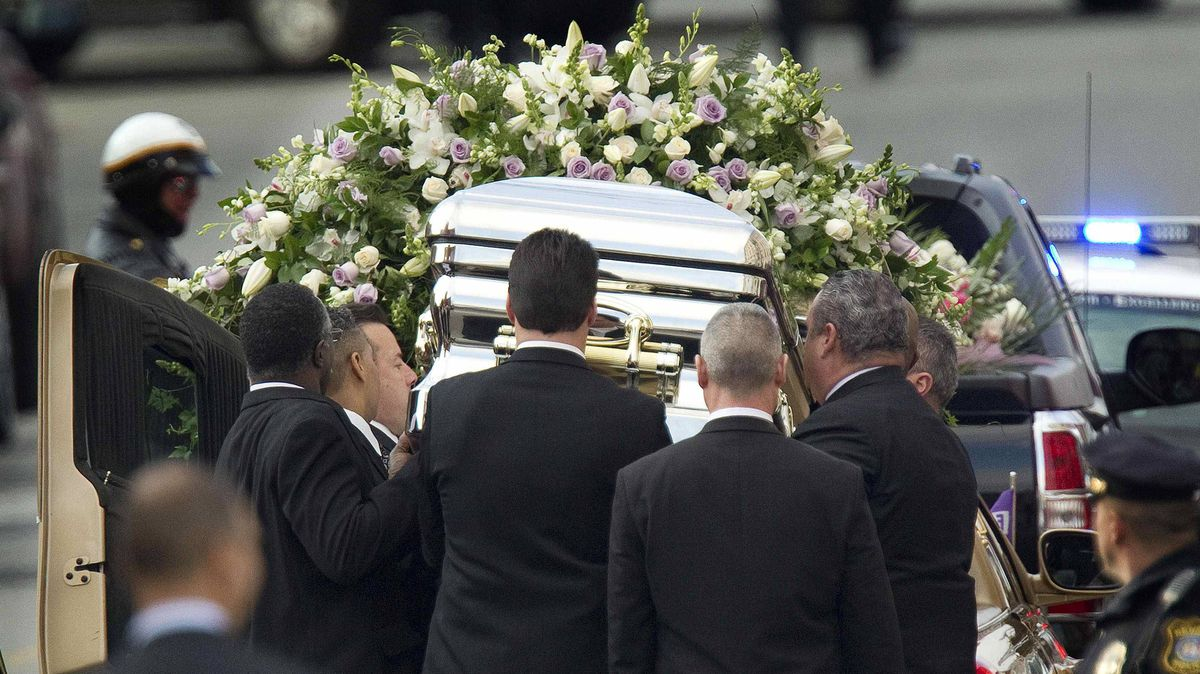 Pallbearers place Whitney Houston's casket into a hearse at the New Hope Baptist Church in Newark, N.J., on Saturday.