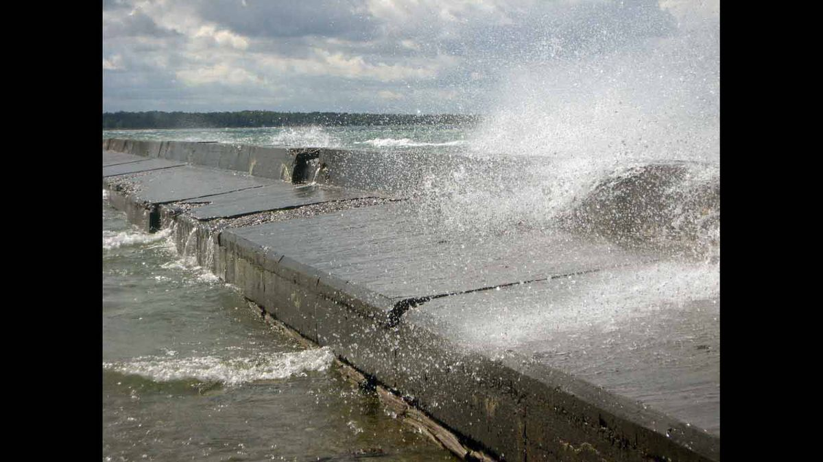 Taken with handheld camera on the Port Elgin, Ontario breakwall during rough waters, 2009.