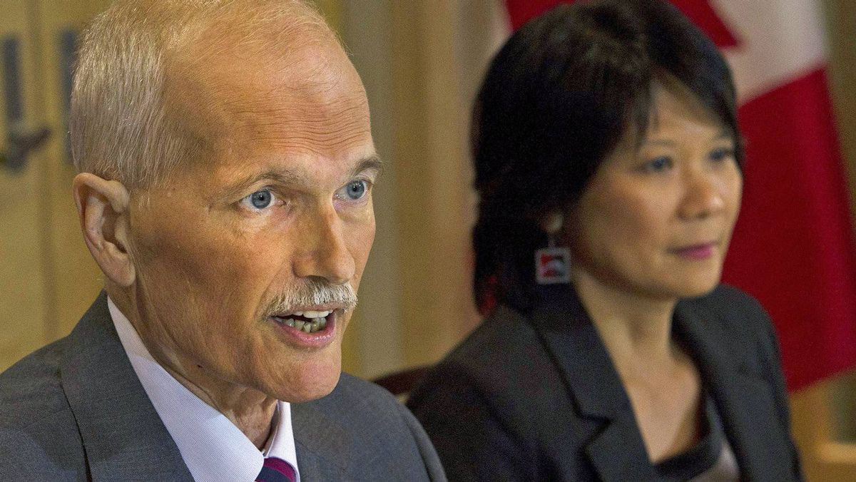 With his wife Olivia Chow by his side, NDP Leader Jack Layton announces he is stepping aside temporarily to battle a second cancer at a Toronto news conference on July 25, 2011.