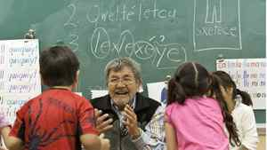 Native Elder Lawrence Michel talks with the kids in the class room teaching traditional words at Chief Atahm School in Chase, B.C.