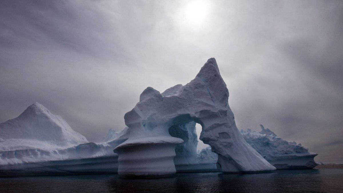 An iceberg melts off Ammassalik Island in Eastern Greenland in this July 19, 2007 file photo.