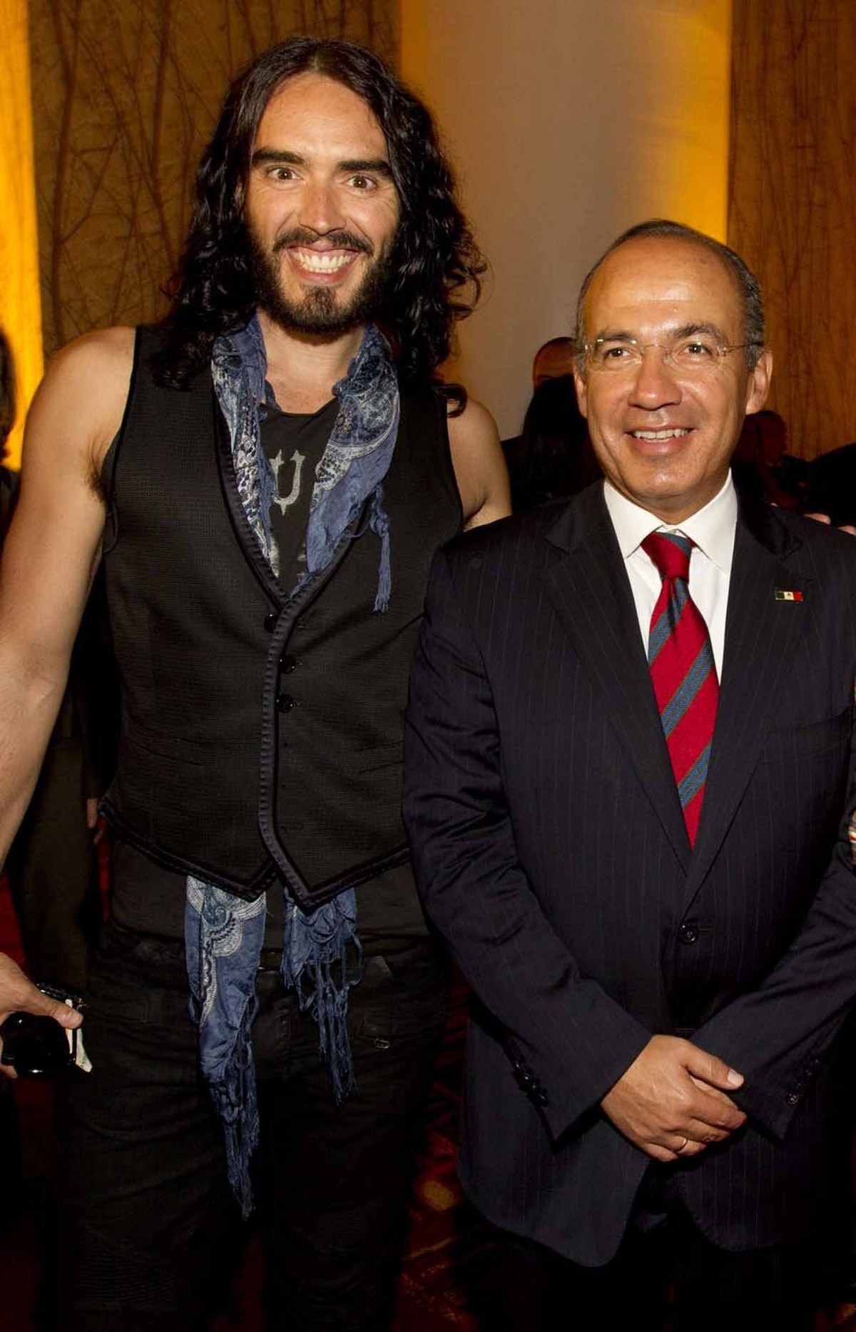 Russell Brand (left) photo-bombs the president of Mexico, Felipe Calderon, at an event in Los Angeles last week.