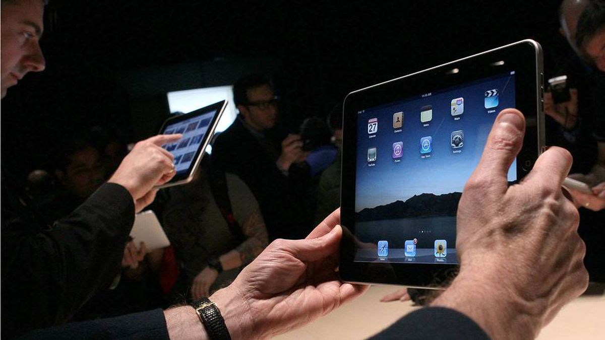Guests play with the new Apple iPad during a special event in January, in San Francisco.