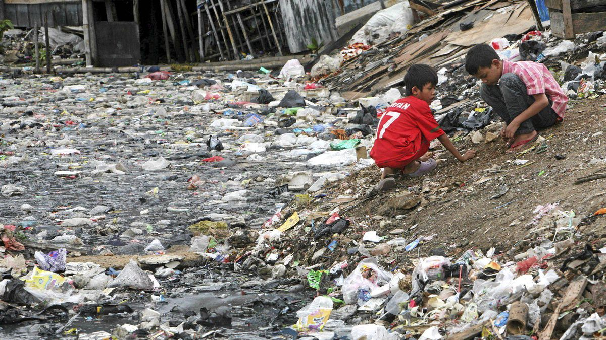 Indonesian children play near a heavily polluted river in Jakarta, Indonesia, Tuesday, March 22, 2011. March 22 is adopted by the United Nations as World Water Day to raise awareness of freshwater and advocate for the sustainable management of freshwater resources around the world.