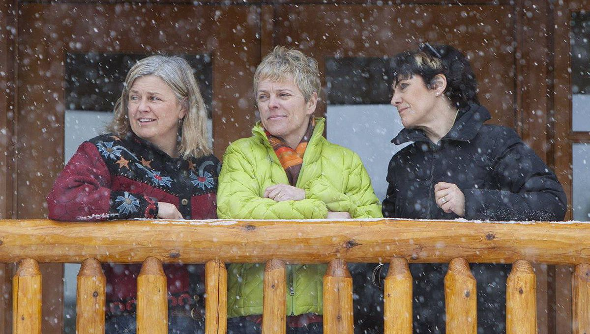 The Brewster sisters (left to right): Alison Brewster, Cori Brewster and Janet Brewster-Stanton, stand on the balcony of a room at their lodge in Banff, Alta.