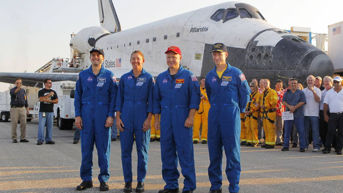 Space shuttle Atlantis crew pose on the runway July 21, 2011 at Kenedy Space Center in Florida after Atlantis landed.