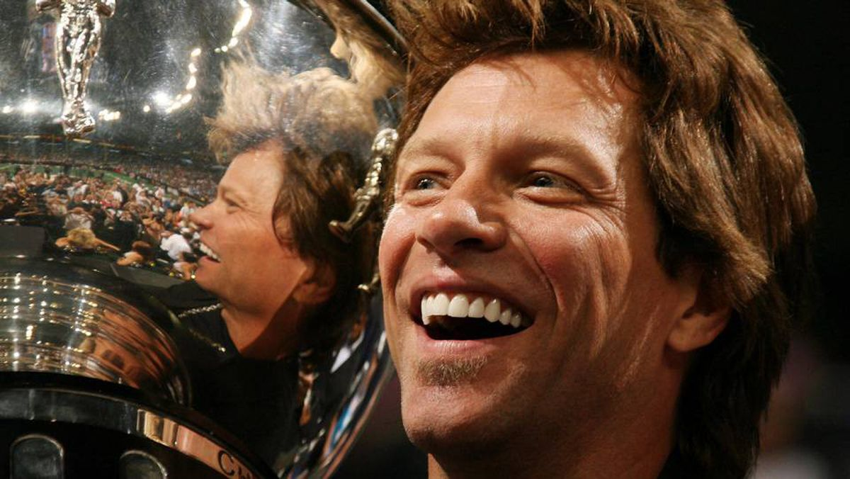 Jon Bon Jovi co-owner of the Philadelphia Soul celebrates with the trophy at the end of the Arena Bowl XXII at the New Orleans Arena on July 27, 2008 in New Orleans, Louisiana. The Philadelphia Soul defeated the San Jose SaberCats 59 to 56.