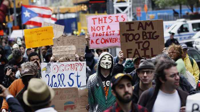 Members of the Occupy Wall Street movement take part in a protest march through the financial district of New York Oct. 12, 2011.
