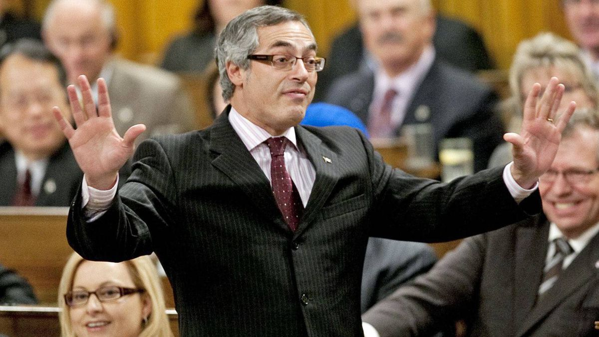 Treasury Board President Tony Clement speaks during Question Period in the House of Commons on Nov. 14, 2011.