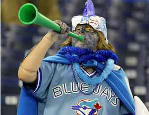 A Blue Jays fan cheers on the team during Opening Day at the Rogers Centre this season.