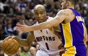 Toronto Raptors guard Jarrett Jack, left, drives against Los Angeles Lakers guard Jordan Farmar during the second half of their NBA basketball game in Toronto on Monday.