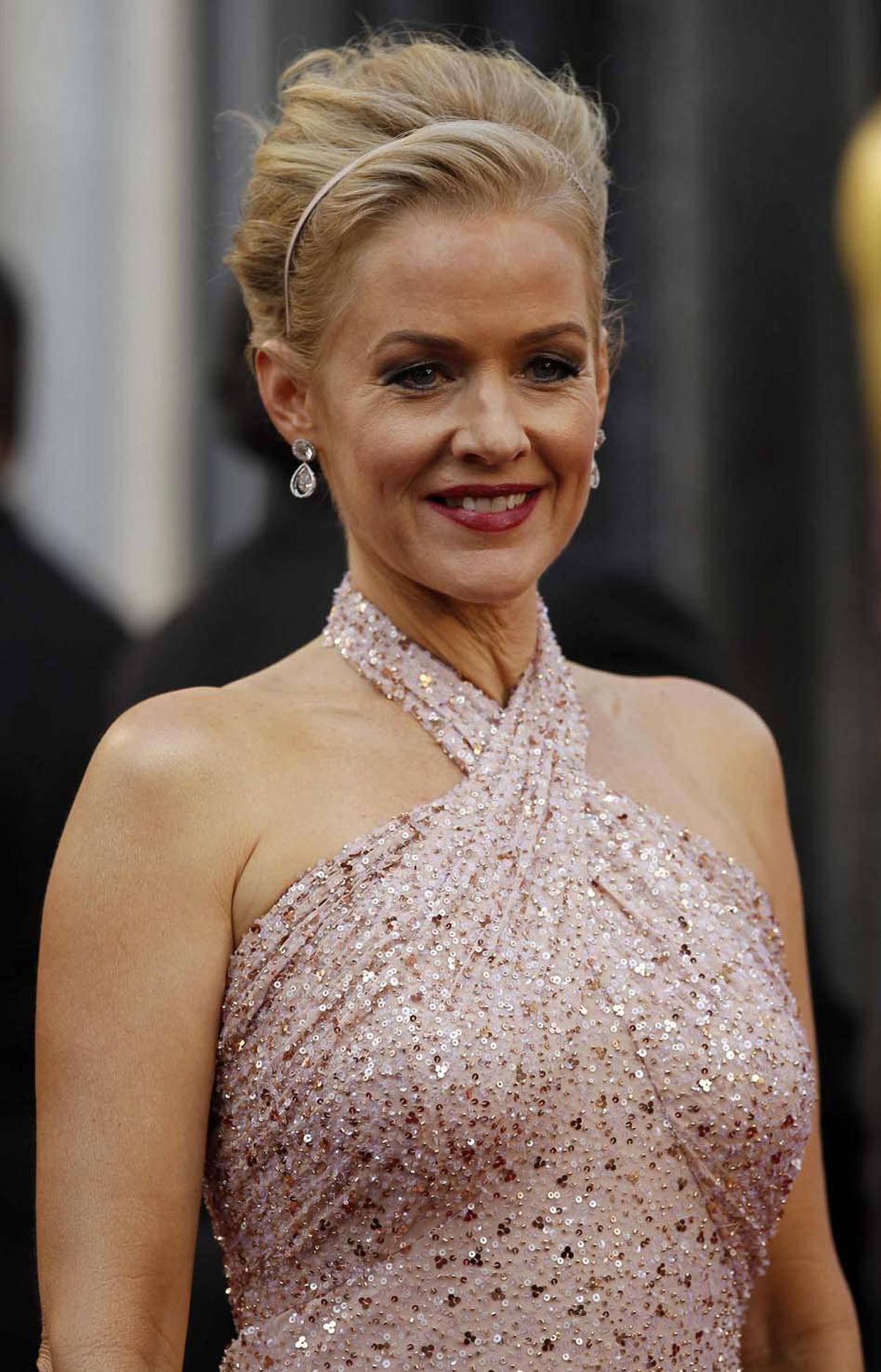 "We're obliged to continue, however. Penelope Ann Miller from ""The Artist"" on the Oscars red carpet."