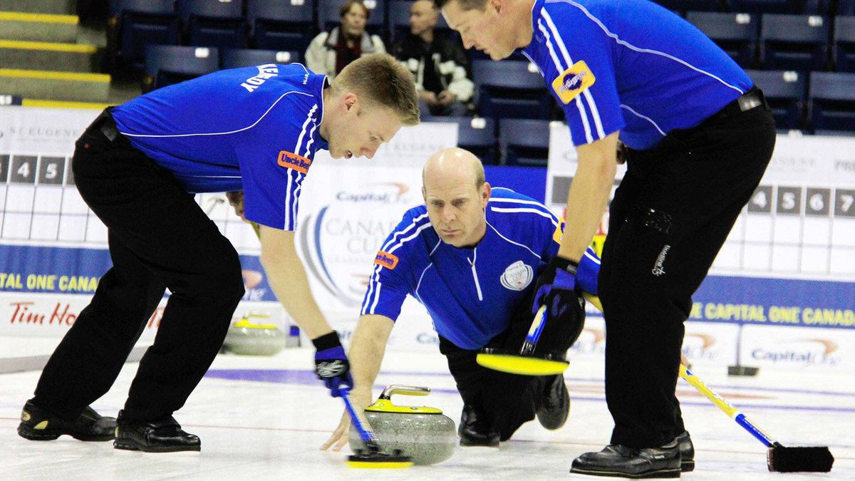 Skip Kevin Martin (centre) plays a rock while second Marc Kennedy and lead Ben Hebert sweep during the second draw of the Capital One Canada Cup of Curling in Cranbrook, B.C. on Wednesday, Nov. 30, 2011.