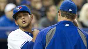 Toronto Blue Jays starting pitcher Henderson Alvarez checks his neck with manager John Farrell (right) after getting hit by an errant throw during second inning AL action against the Tampa Bay Rays in Toronto on Thursday April 19, 2012.