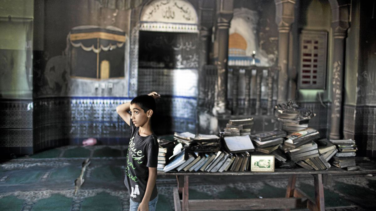 An Arab-Israeli boy inspects a burnt mosque after it was torched in the northern Israeli Bedouin village of Tuba-Zangariya on Monday.