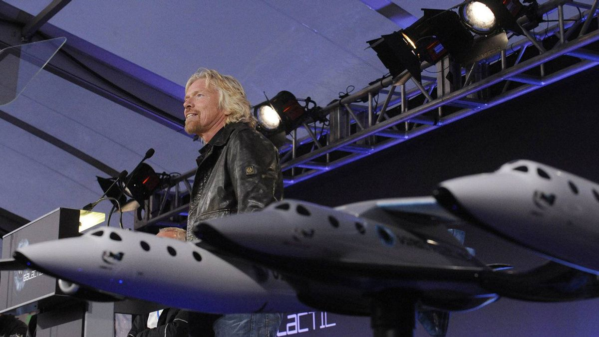 Richard Branson speaks at a news conference before Virgin Galactic unveiled its new commercial spaceship SpaceShipTwo in Mojave, Calif., in 2009.