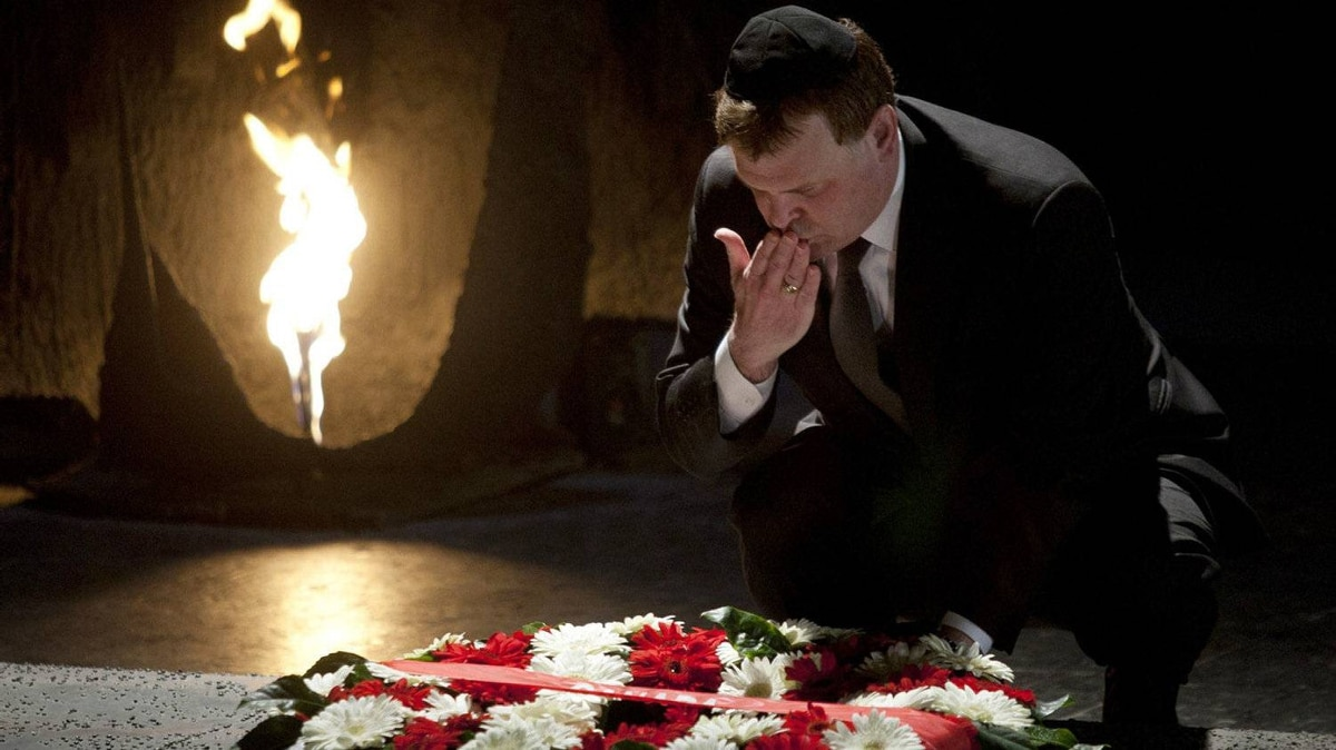 Canadian Foreign Minister, John Baird, lays a wreath at the Hall of Remembrance at the Yad Vashem Holocaust memorial, in Jerusalem, Monday, Jan. 30, 2012.