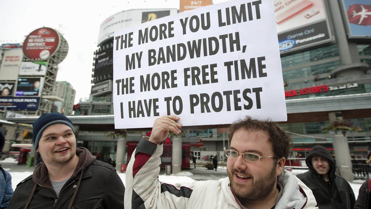 Demonstrators gather for a 'Stop The Internet Meter' rally to protest usage-based internet billing in downtown Toronto, Friday, February 4, 2011.