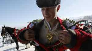 "Wojtek Bucki Jr. adjusts his clothes prior to the start of the ""Kumoterki"" race."