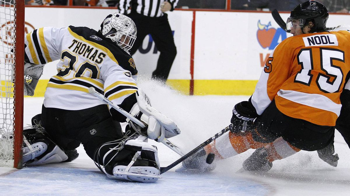 Boston Bruins' Tim Thomas (30) blocks a shot by Philadelphia Flyers' Andreas Nodl (15), of Austria, in the second period of an NHL hockey game, Sunday, March 27, 2011, in Philadelphia. The Bruins won 2-1 and clinched a postseason berth. (AP Photo/Matt Slocum)