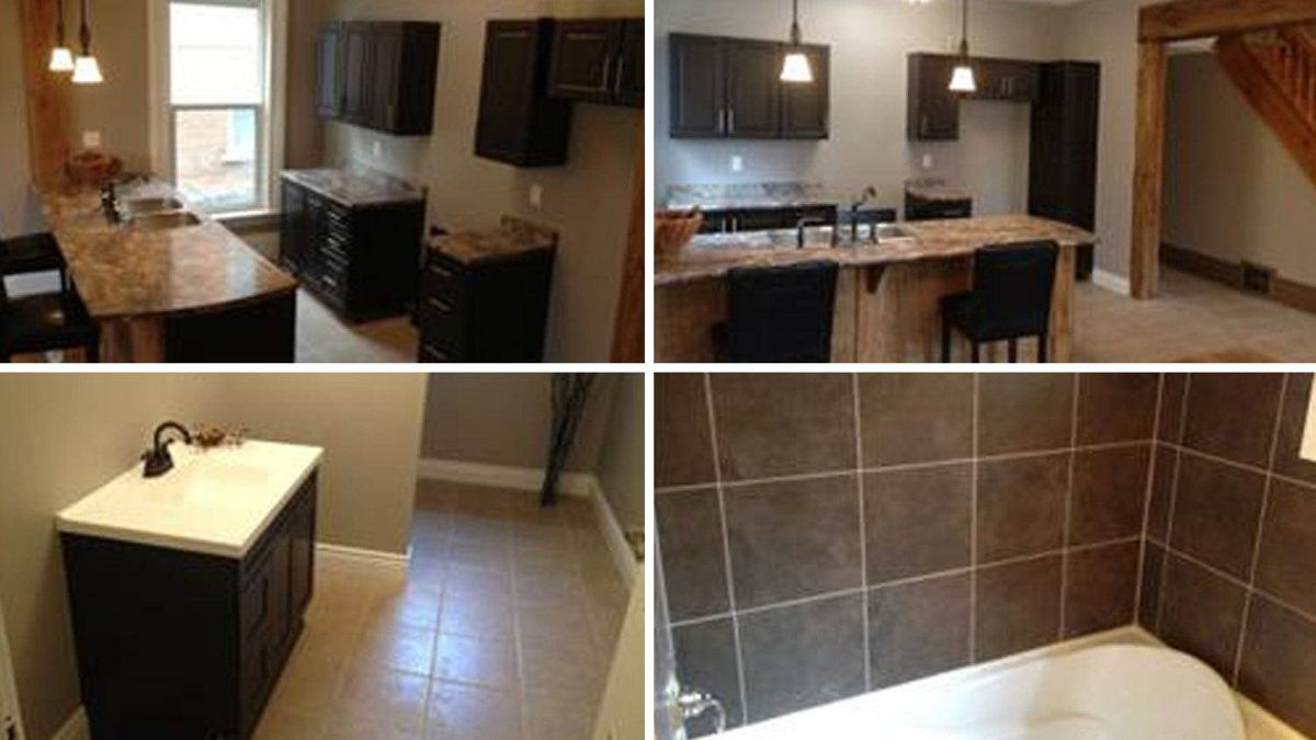 The open concept kitchen with breakfast bar is renovated, along with the two bathrooms.